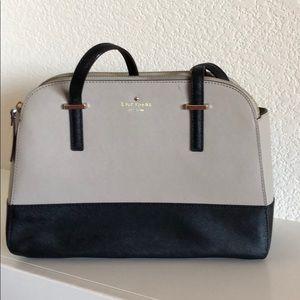 Kate Spade tan and navy handbag.